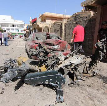 Civilians gather at the site where a car bomb went off outside the building housing Swedish and Finnish consulates Benghazi (AP)