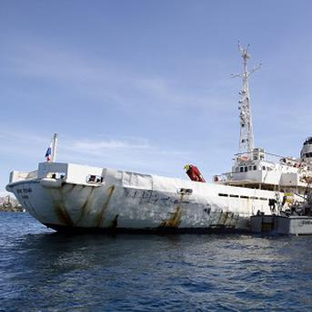 A Venezuelan coast guard boat sits next to the survey ship Teknik Perdana docked near the shore on Margarita Island (AP)
