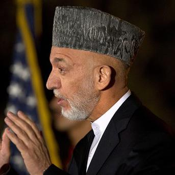 Afghan president Hamid Karzai faces a deadline for a security deal about the future of US troops in the country (AP)