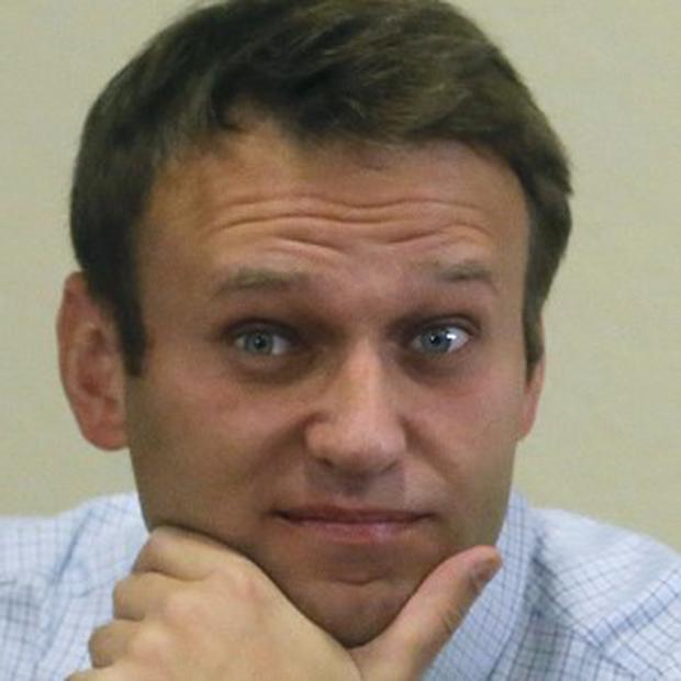 Russian opposition leader Alexei Navalny has had a jail sentence overturned on appeal (AP)