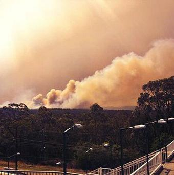 Smoke rises from a fire near Springwood, west of Sydney