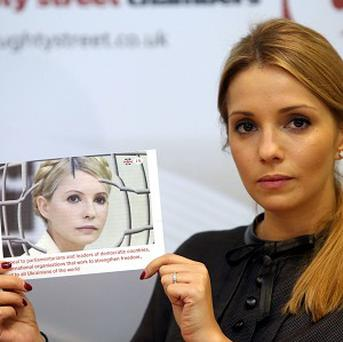 Eugenia Tymoshenko holds a photograph of her mother, the jailed former Prime Minister of Ukraine Yulia Tymoshenko.
