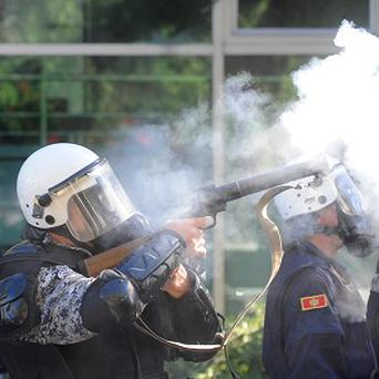 A police officer fires tear gas during a gay pride march in Montenegro (AP)