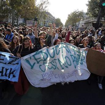 Protesting students demonstrate in Paris over the expulsion of immigrant families (AP)