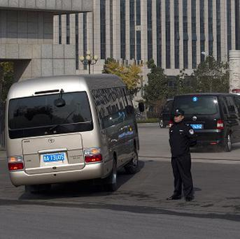 A convoy of vehicles believed to be carrying ousted Chinese politician Bo Xilai enters Shandong Provincial Higher Peoples Court (AP/Alexander F Yuan)