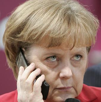 A German delegation is to visit the US amid a row over claims the NSA bugged Angela Merkel's phone