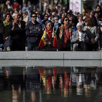People gather during a demonstration in Madrid to protest the release from jail of Basque separatists (AP)