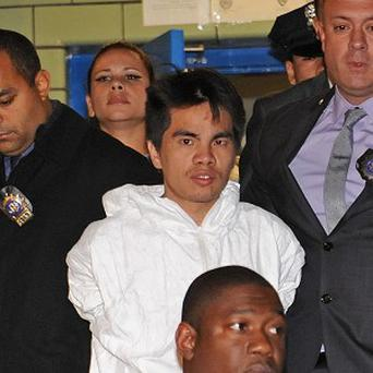 Mingdong Chen, suspected of murdering five people in Brooklyn's Sunset Park neighbourhood, is led away by police.