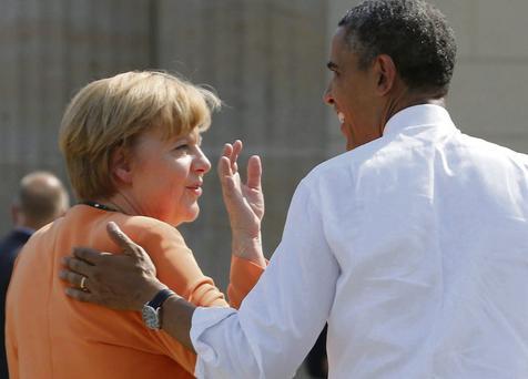 US President Barack Obama with German Chancellor Angela Merkel in Berlin last June