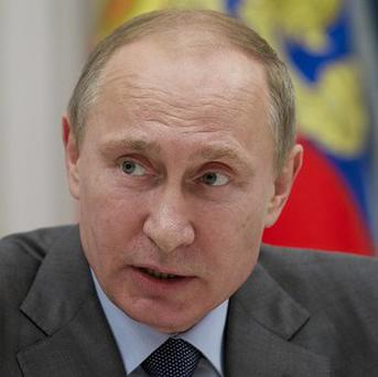 Vladimir Putin has tried to calm international fears over Russia's attitude to gays at the winter Olympics (AP)