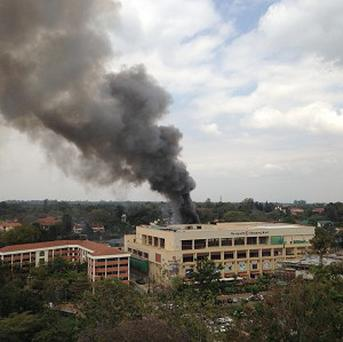 The Westgate Mall in Nairobi at the height of the siege (AP)