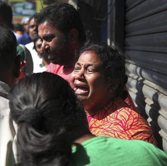 Relatives of passengers cry outside the office of a private bus operator in Hyderabad after a fatal crash (AP)