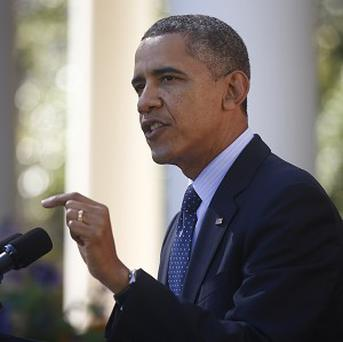 President Barack Obama says there is no excuse for the problems being suffered by people trying to sign up for health coverage.