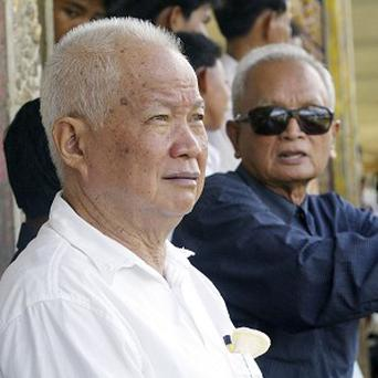 Former Khmer Rouge leaders Khieu Samphan, left, and Nuon Chea, right, are on trial (AP)