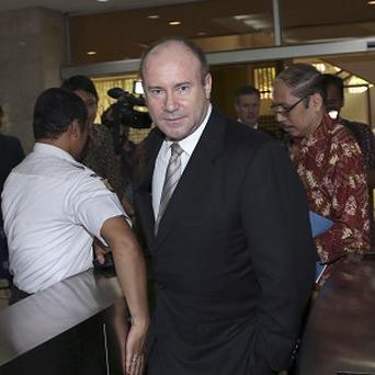 Australian Ambassador to Indonesia Greg Moriarty, front, arrives at the Indonesian Foreign Ministry in Jakarta, where he was summoned over a spying row.