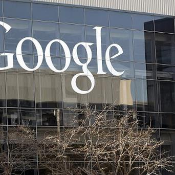 A Google sign at the company's headquarters in California. A woman plans to fight a traffic ticket she was handed for wearing Google's Internet-connected eyeglasses.