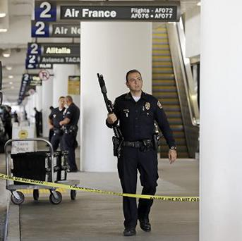Police stand guard at Los Angeles International Airport (AP)