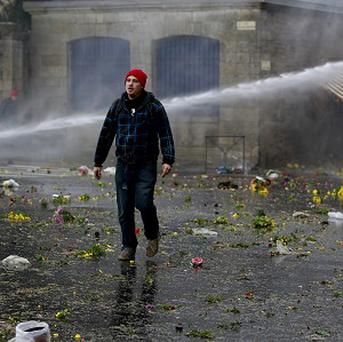 Riot police use water canons to disperse protesters during clashes in Quimper, France.