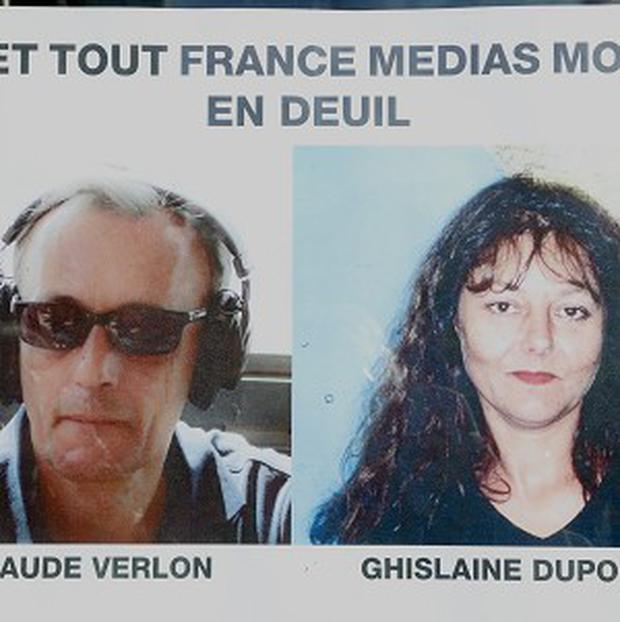 French journalists, Ghislaine Dupont, right, and Claude Verlon (AP Photo/Jacques Brinon)