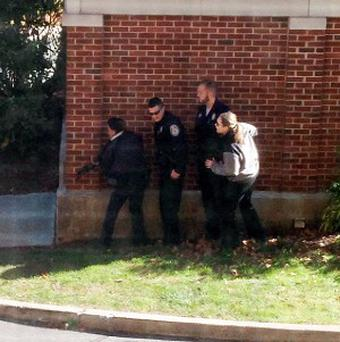 Police officers respond to a report of a suspicious person at Central Connecticut State University (AP/Kiara Gupton via WFSB)