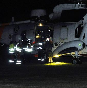 Emergency personnel surround a helicopter near the site of a bus hijacking in Aardal, western Norway where a knife-wielding man hijacked a bus and killed three people on board (AP)