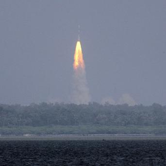 The Polar Satellite Launch Vehicle (PSLV-C25) rocket lifts off carrying India's Mars spacecraft from the east coast island of Sriharikota (AP)