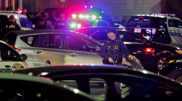 Police secure the area after reports that a gunman fired shots at the Garden State Plaza mall in Paramus, New Jersey, November 4, 2013.