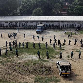Security officials stand guard outside a special court in Dhaka, Bangladesh (AP)