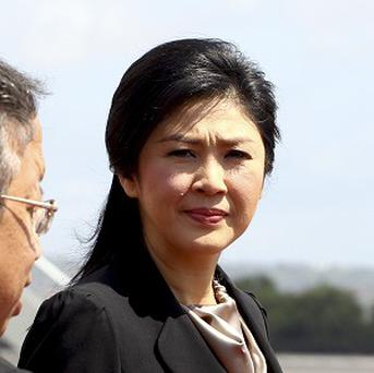 Thai prime minister Yingluck Shinawatra has defended the political amnesty bill (AP)