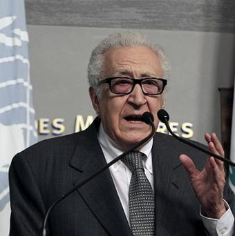 Lakhdar Brahimi says diplomats are trying to see if the peace conference can be held before the end of the year (AP)