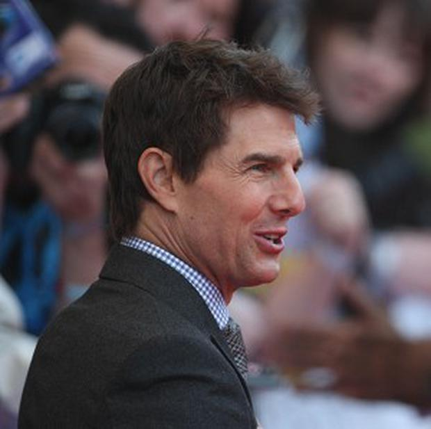 Tom Cruise has said he maintains a close relationship with his daughter Suri, during a defamation case against Bauer Publishing