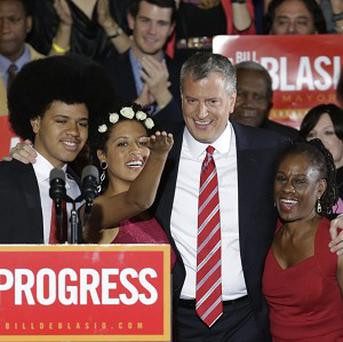 Bill de Blasio with son Dante, daughter Chiara and wife Chirlane after he was elected the first Democratic mayor of New York City in 20 years (AP)