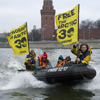Greenpeace International activists pass the Kremlin on the Moskva River as they protest against Russia's detention of members of the environmental group (AP)