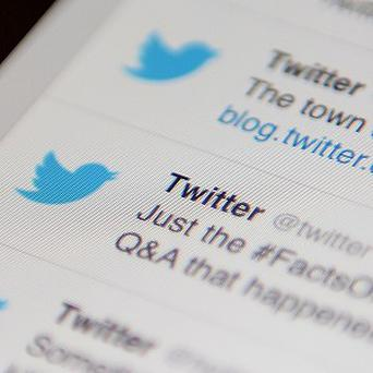 Twitter shares have opened at 45.10 dollars (£28.11) on its first day of trading, 73% above its initial offering price.