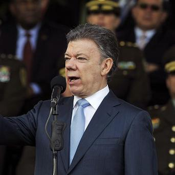 Colombia's President Juan Manuel Santos speaks at a police cadets graduation ceremony in Bogota as his representatives and rebel negotiators reached a parital peace deal in Havana, Cuba.