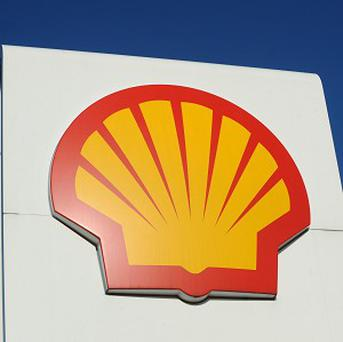 Refining and trading cushioned a drop in Royal Dutch Shell's first quarter profits, which fell less than expected after the collapse in oil prices slashed earnings from oil and gas output.
