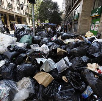 Accumulated rubbish piles up on a street during a strike by council workers in Santiago.