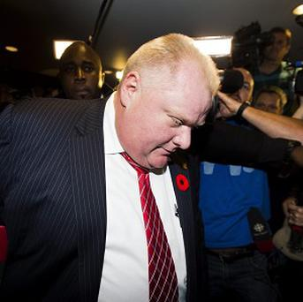 Mayor Rob Ford arrives at his office surrounded by the media in Toronto (AP/The Canadian Press, Nathan Denette)