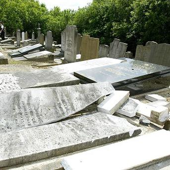 A Jewish cemetery desecrated by vandals.