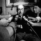 Pablo Neruda talking to reporters in Paris in 1971 after being awarded the Nobel Prize (AP)
