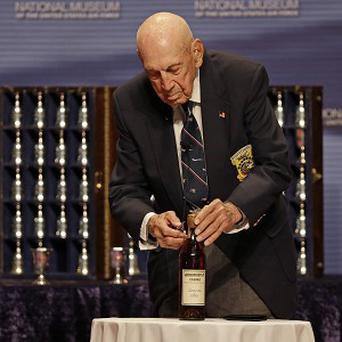 Doolittle raider Richard Cole opens an 1896 bottle of cognac he and his comrades had been saving for their final toast.