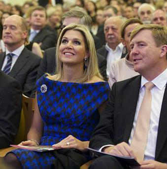 King Willem-Alexander of the Netherlands, right, and Queen Maxima at the concert by the Royal Concertgebouw Orchestra in Moscow (AP)