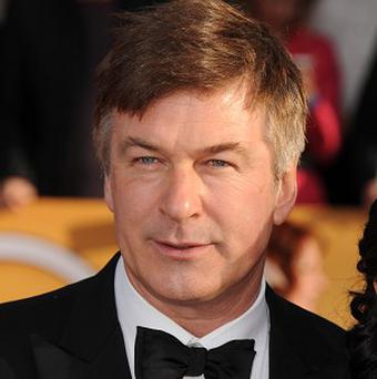 FILE - In this Jan. 27, 2013 file photo, Alec Baldwin arrives at the 19th Annual Screen Actors Guild Awards at the Shrine Auditorium in Los Angeles. Baldwin is expected to testify Tuesday, Nov. 12, 2013, in Genevieve Sabourins (ZHAHN'-vee-ehv sah-boor-EHN') trial in New York City. Prosecutors say she bombarded the actor with messages professing her love and showed up uninvited at his New York and Hamptons homes in 2012. (Photo by Jordan Strauss/Invision/AP, File)