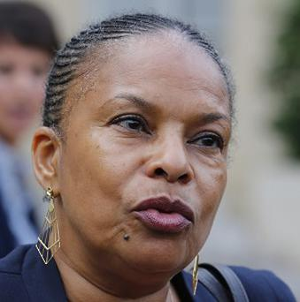French justice minister Christine Taubira has been the subject of racist insults (AP)