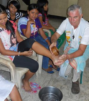 Fr.Shay Cullen (70) washing the feet of child survivors of trafficking and exploitation at the Preda foundation