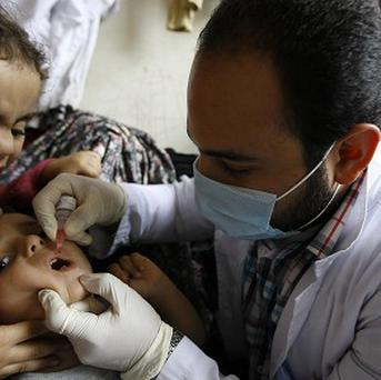 A Syrian child refugee gets a polo vaccination in Lebanon (AP)