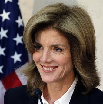 New US ambassador Caroline Kennedy smiles as she gives a statement upon her arrival in Japan (AP)