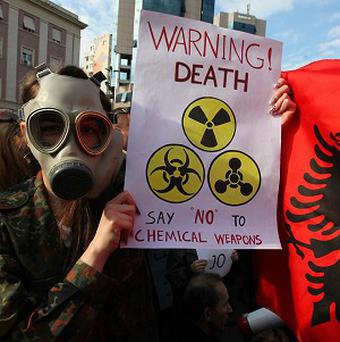 An Albanian student protests in the capital Tirana against plans to dismantle Syrian chemical weapons in Albania (AP)