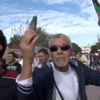 Image made from video showing a protester holding up spent ammunition in Tripoli, Libya, after militiamen attacked peaceful protesters (AP)