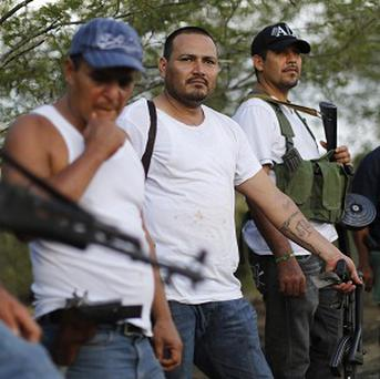 A self-defence group at a checkpoint in the Mexican state of Michoacan